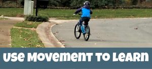 Cover image for How to Use Movement to Help Your Children Learn showing a boy riding bike..