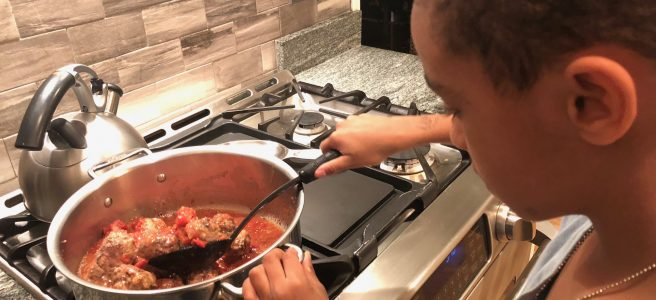 Stirring meatballs on the stove