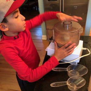 Child using a food processor