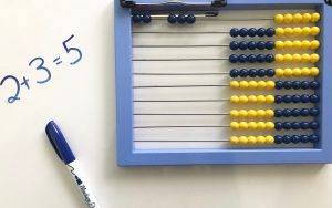 Abacus showing 2 + 3 on the top row.