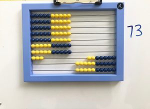 Abacus showing 73.