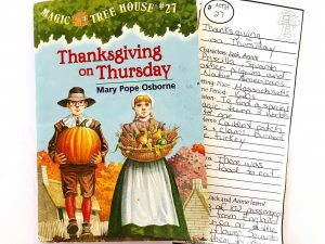 Magic Tree House Thanksgiving on Thursday book with a completed printable reading comprehension bookmard