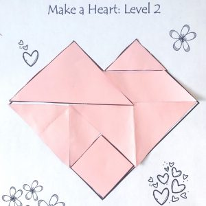 Heart Tangram put together on a paper
