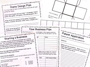 Game Design planning sheet, blank game board and dice, business plan, and patent application sheets.