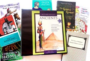 Notebook of Ancient History curriculum surrounded by related books.