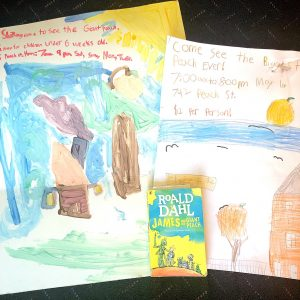 Painted posters of a scene in James and the Giant Peach with the book.
