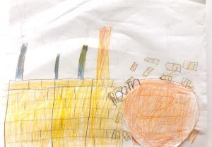 Child drawn picture of peach rolling into a factory.
