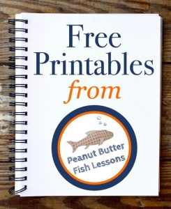 Notebook with graphic on it that says FREE Printables and shows the Peanut Butter Fish Lessons logo