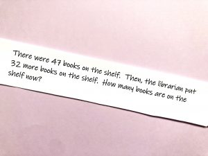 Printed math story problem where two amounts are combined and the student needs to find the sum.